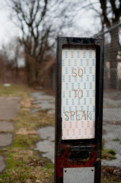 So to Speak, screenprinted ceramic tile installed in former payphone site, 2013